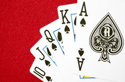 Biggest hand in Poker game on red background Stock Image
