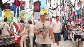 Biggest and most crowded bazaar in the city. Located in Bostanli, Karsiyaka. IZMIR - JULY 2015: Biggest and most crowded bazaar in the city. Located in Bostanli stock video footage