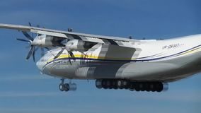 Big aircraft takes off. The biggest propeller cargo transport aircraft in the world AN-22 Antey up to speed on the runway and takes off into the sky stock footage