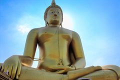Biggest Sitting Buddha in Thailand in Ang Thong, Thailand. A Buddha sits in Ang Thong, Thailand near the laying down Buddha. Its golden reflection, giant Royalty Free Stock Photos