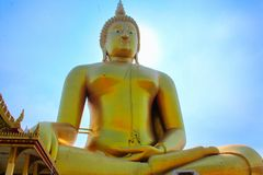 Biggest Sitting Buddha in Thailand in Ang Thong, Thailand. A Buddha sits in Ang Thong, Thailand near the laying down Buddha. Its golden reflection, giant Stock Photo