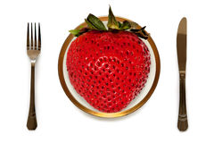 Biggest strawberry on your plate; folk, knife