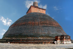 The biggest stupa in the world Jethawanaramaya Dagoba. The biggest  ancient stupa in the world Jethawanaramaya Dagoba against the blue sky in Anuradhapura, Sri Stock Photo