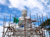 Biggest white stone Buddha under construction. Royalty Free Stock Photos