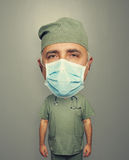 Bighead doctor in mask and uniform Royalty Free Stock Images