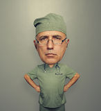 Bighead doctor over grey Royalty Free Stock Photography