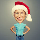 Bighead girl in santa hat. Over grey background Royalty Free Stock Photo