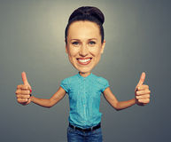 Bighead girl showing thumbs up stock images