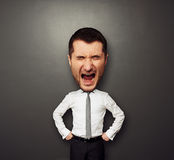 Bighead man is screaming. Photo of bighead man is screaming over dark background Royalty Free Stock Photos