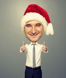Bighead santa man showing thumbs up. And smiling Stock Images