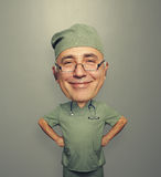 Bighead satisfied doctor in glasses Stock Photography