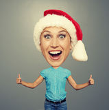 Bighead woman in santa hat Stock Images