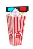 Biglietti di film del popcorn e vetri 3D Immagini Stock