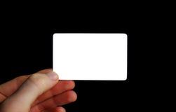 Biglietto da visita in bianco isolato sul nero Fotografie Stock