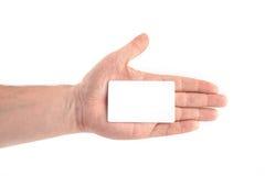 Biglietto da visita in bianco in una mano Fotografie Stock Libere da Diritti