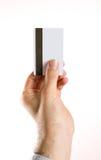 Biglietto da visita della tenuta della mano, verticale della carta di credito Fotografia Stock