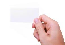 Biglietto da visita isolato della holding della mano Fotografia Stock Libera da Diritti