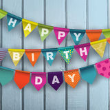 Biglietto di auguri per il compleanno felice con le ghirlande di carta variopinte Immagini Stock Libere da Diritti