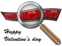 Biglietto di S. Valentino con i cuori sotto la lente d'ingrandimento Fotografia Stock Libera da Diritti