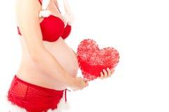 Biglietto di S. Valentino incinto sexy con cuore rosso fotografia stock