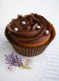 Bigné del cioccolato con la crema del cioccolato Immagini Stock