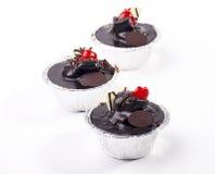 Bigné del cioccolato isolati su fondo bianco Immagini Stock Libere da Diritti