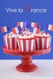 Bigné felici di giorno di Bastille Fotografia Stock