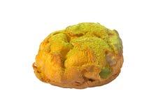 bigne奶油色绿色酥皮点心被充塞的茶 图库摄影