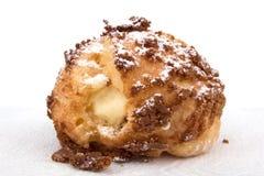 Bigne rellenó con crema de pasteles Foto de archivo libre de regalías