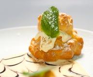 Bigne stuffed with pastry cream Stock Images