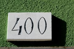 Bignumber 400 with green background Stock Photo