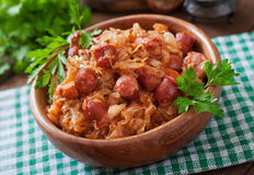 Bigos with smoked sausage and bacon Stock Image