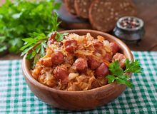 Bigos with smoked sausage and bacon Stock Images