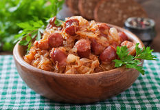 Bigos with smoked sausage and bacon. Polish bigos with smoked sausage and bacon Royalty Free Stock Images