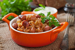 Bigos with smoked sausage and bacon Stock Photos
