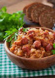 Bigos with smoked sausage and bacon. Polish bigos with smoked sausage and bacon Royalty Free Stock Image
