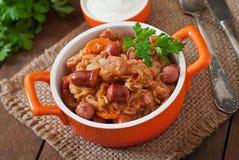 Bigos with smoked sausage and bacon Stock Image