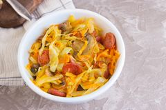 Bigos - stewed cabbage with carrots , smoked sausages and mushrooms, traditional dish of polish cuisine.  stock images