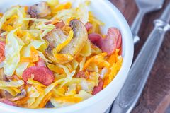 Bigos - stewed cabbage with carrots , smoked sausages and mushrooms, traditional dish of polish cuisine.  royalty free stock image