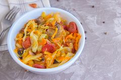 Bigos - stewed cabbage with carrots , smoked sausages and mushrooms, traditional dish of polish cuisine.  royalty free stock images