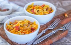Bigos - stewed cabbage with carrots , smoked sausages and mushrooms, traditional dish of polish cuisine.  royalty free stock photo