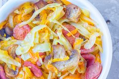 Bigos - stewed cabbage with carrots , smoked sausages and mushrooms, traditional dish of polish cuisine.  royalty free stock photography