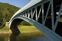 Bigsweir Bridge, a single span iron bridge over the River Wye an. Bigsweir bridge crosses between Wales and England, in the united kingdom, it spans the River Stock Photos