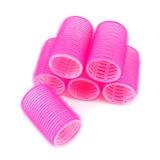 Bigudíes de pelo rosados en blanco fotografía de archivo