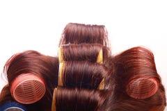 Bigudíes en pelo Imagen de archivo libre de regalías