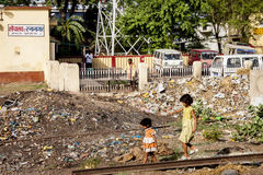 BIHAR, INDIA. JUNE 9, 2009: Indian children walking around garbage near the Son Nagar railway station on JUNE 9, 2009 in Stock Photo