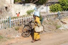 BIHAR, INDIA. JUNE 9, 2009: Indian woman walking in the sidewalk near the Son Nagar railway station on JUNE 9, 2009 in Stock Photography