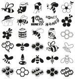 Bij en honingspictogrammen op wit Stock Foto's