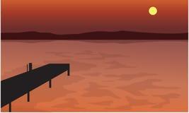 Bij het silhouetlandschap van de Zonsondergangpijler Royalty-vrije Stock Foto