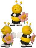 Bij met bloem - klein stuk speelgoed Stock Foto's